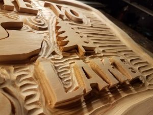 Detail of Wood Carved Sign