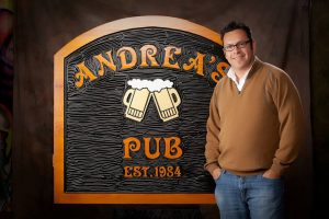 Jim Standing nest to Andrea's Pub Sign